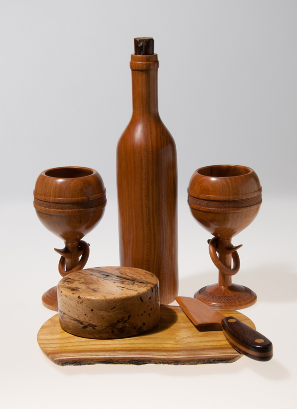 "Scott Schlapkohl. ""Wooden Wine and Cheese."" 2014. Wood, 13""x12""x12"". SOLD. This artwork was selected by the exhibit Jurors to receive an Award of Excellence."