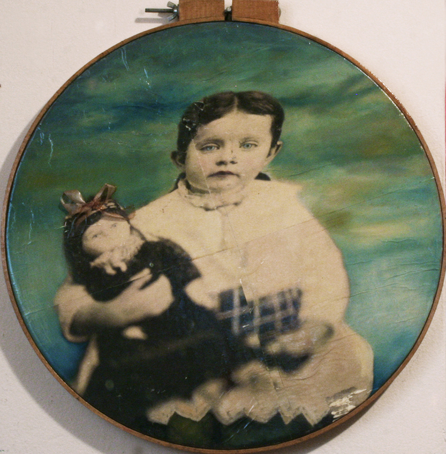 "Christa Gearhart Denney."" Girl with Doll."" 2014. Xerox®™ Transfer Transfer, Oil, Found Objects, 23""x24"". $1,100."
