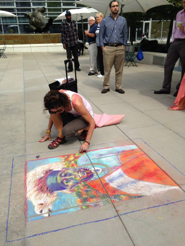 Artist Muriel Eulich working her magic on the Plaza pavement.