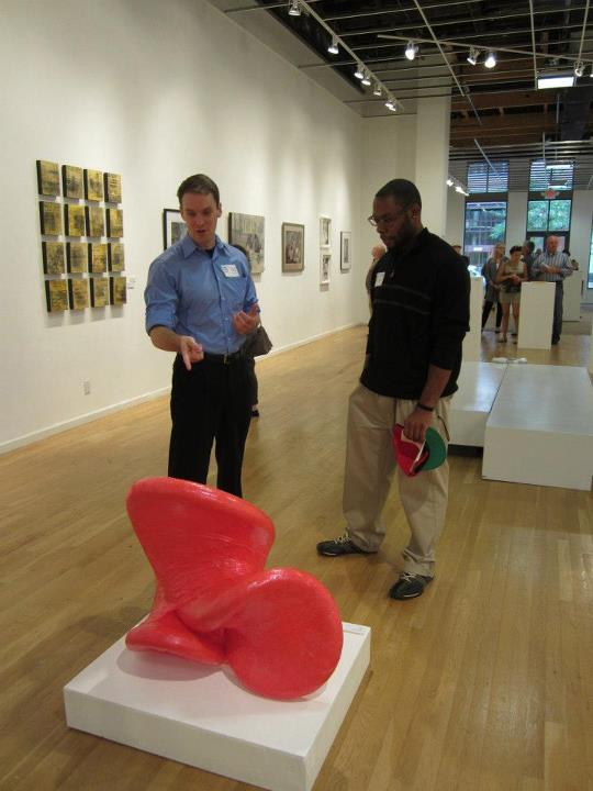 Featured artist Dennis Dwight Isom chatting with me about his work. Opening reception @ ASL, August 11, 2012. Photo by Robin Hirsch.