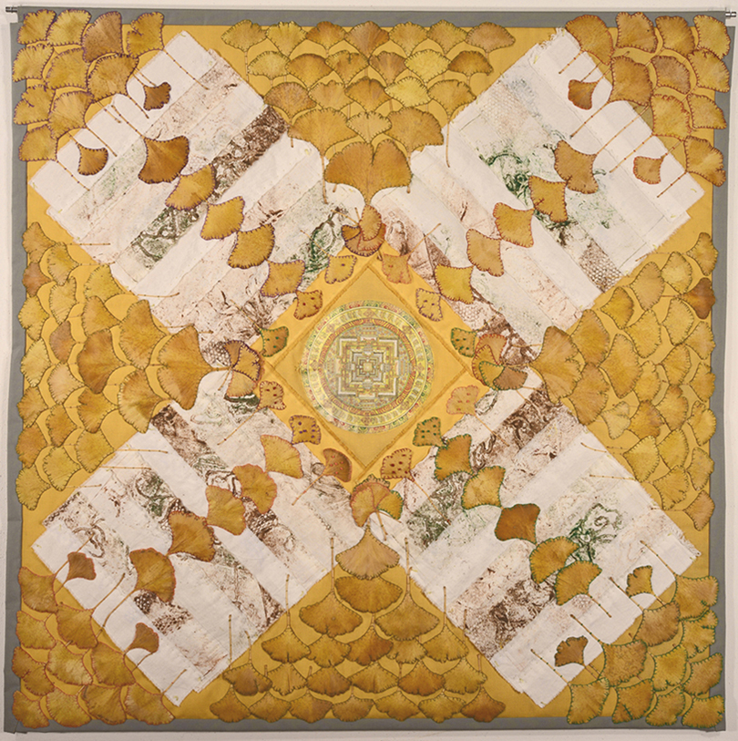 "Kacey Cowdery, Webster Groves, MO. ""Path of Life."" 2014. Cotton Poplin, Cotton Muslin, Printed by Collography Method, Painted Paper Mandala from Nepal, Natural Preserved Ginko Leaves, Leaves Lined with Polyester, Blanket Stitched with Floss, French Knots, 40""x40"". $1,600."