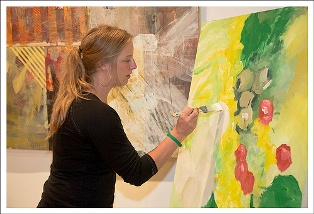Member Artist Megan Rieke painting live in the Art Saint Louis Gallery, April 28, 2012. Photo by Robert Crowe.