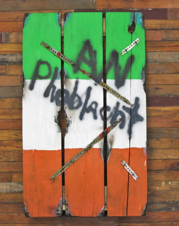 "Dennis M. Corcoran. An Phoblacht (The Republic). 2013. Wood, Painted, Burned, Shot, Strap Steel, 60""x36"".  $1,500."