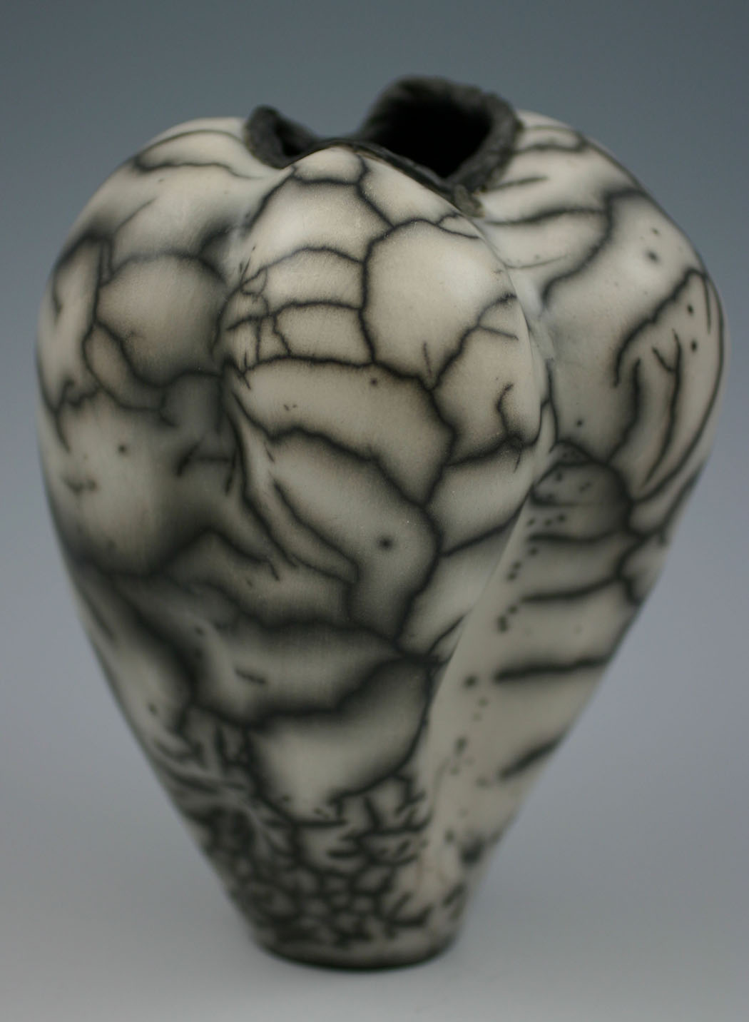 "Jane Hoeltzel. Heartbeat. 2012. Naked Raku Stoneware, All Glaze Removed, 6.5""x5"". The jurors selected this artwork for an Award of Excellence."